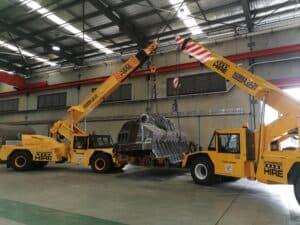 2 cranes lifting machinery